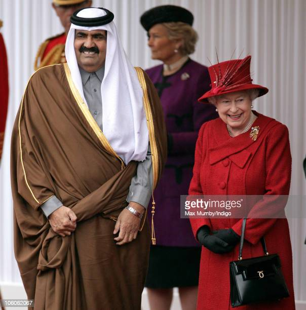The Emir of the State of Qatar, Sheikh Hamad bin Khalifa Al-Thani and Queen Elizabeth II attend the ceremonial welcome for The Emir and Her Highness...