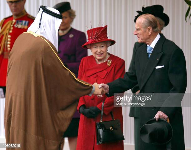 The Emir of the State of Qatar Sheikh Hamad bin Khalifa AlThani greets Prince Philip The Duke of Edinburgh and Queen Elizabeth II at the ceremonial...