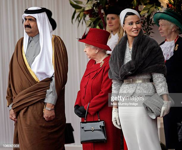 The Emir of the State of Qatar Sheikh Hamad bin Khalifa AlThani Queen Elizabeth II and Sheikha Mozah bint Nasser AlMissned at the ceremonial welcome...