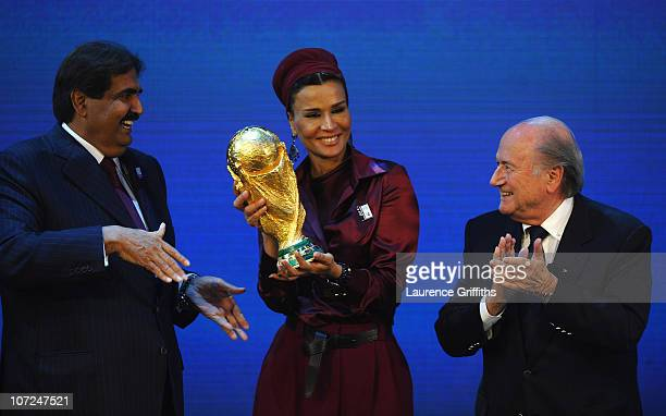 The Emir State of Qatar HH Sheikh Hamad bin Khalifa AlThani and Sheikha Mozah bint Nasser Al Missned are presented with the World Cup Tophy by FIFA...