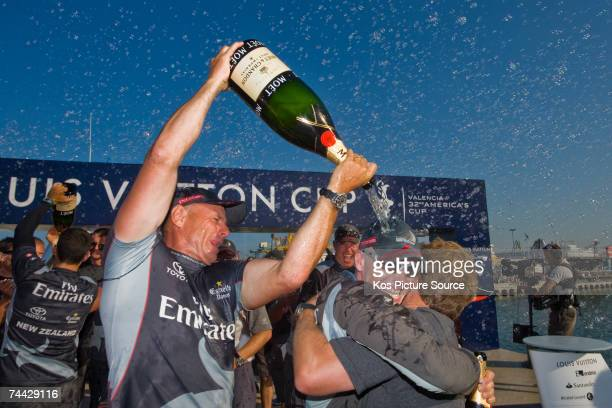 The Emirates Team New Zealand crew celebrates as Emirates Team New Zealand NZL92 wins the fifth and final race of the Louis Vuitton Cup Final on June...