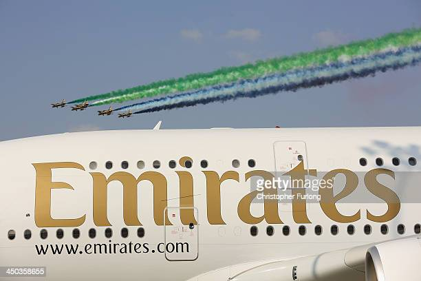 The Emirati Al-Fursan aerobatic team fly past an Emirates A380 during the Dubai Airshow on November 18, 2013 in Dubai, United Arab Emirates. The...