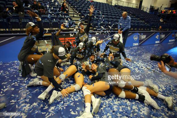The Emory Eagles celebrate after defeating the Calvin Knights during the Division III Women's Volleyball Championship held at the AJ Palumbo Center...