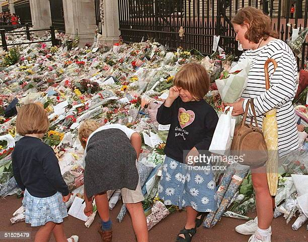 The emotional pressure gets too great for this young visitor to Buckingham Palace 01 September who leave flowers as a sign of respect following the...
