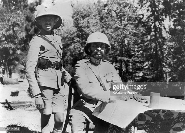 The Emperor Of Ethiopia Haile Selassie And His Son Prince Makonnen Duke Of Harar Drawing Up Military Strategies In Dessie Using The Map Of The...