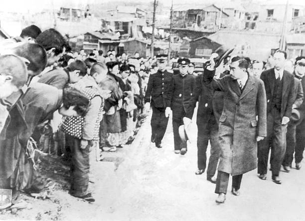 Emperor hirohito greeting his people for the first time 1946 the emperor of japan hirohito taking his hat off to greet the japanese crowds who have m4hsunfo