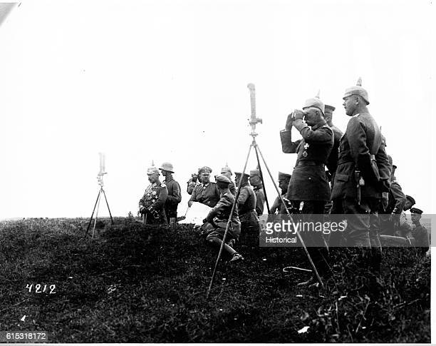 The Emperor Wilhelm II views troops movements from a command post during rear guard engagements Prince Eitel Friedrich stands behind him