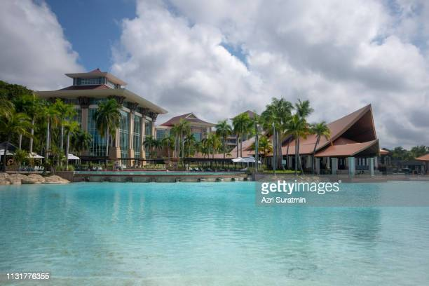 jerudong, brunei- 10 february, 2019:  the empire hotel & country club is a luxury hotel in the sultanate of brunei. the complex consists of 360 rooms, 47 suites and 16 villas with a total of twelve room categories. the empire has a saltwater pool and nine - bandar seri begawan stock pictures, royalty-free photos & images
