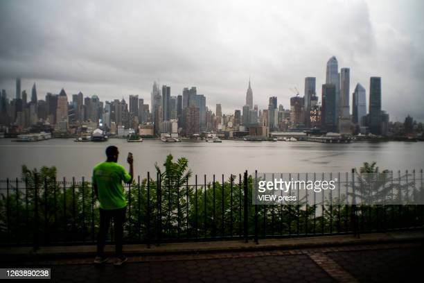 The Empire State Building and Middle Manhattan are pictured as the city gets ready for tropical storm Isaias on August 4 2020 in New York City The...