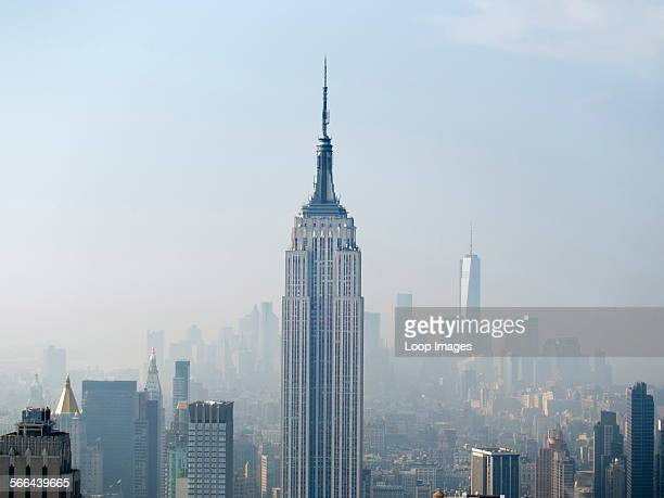 The Empire State Building and new One World Trade Centre viewed from the top of the Rockefeller Building on a misty day