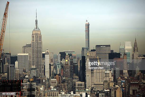 The Empire State building and the skyline of Manhattan is viewed from one of the top floors of the newly built Four Seasons private residences at 30...