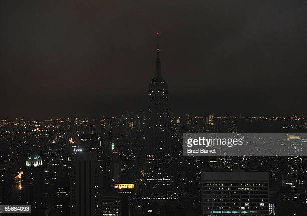 The Empire State Building as seen from the Top of the Rock at Rockefeller Center March 28 2009 moments after it went dark at 830 pm as individuals...