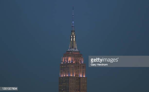 The Empire State Building in New York City displays a number 2 on its mast marking the election of former New York Yankees player Derek Jeter to the...