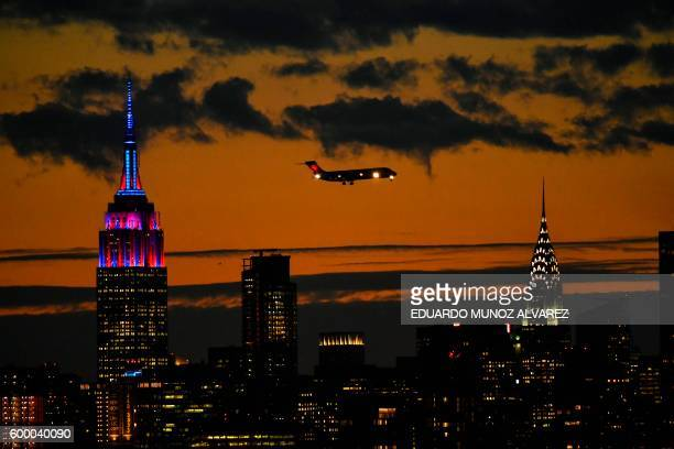 TOPSHOT The Empire State Building is lit in colors of the FC Barcelona football club as seen from the USTA Billie Jean King National Tennis Center in...