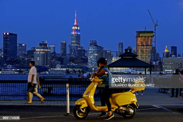 TOPSHOT The Empire State Building is lit in honor of the 2018 World Cup Finalists France and Croatias as people watch the skyline of New York from...