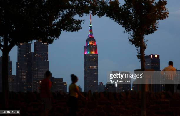 The Empire State Building is lit in rainbow colors celebrating Pride Day in New York City on June 24 2018 as seen from Weehawken New Jersey