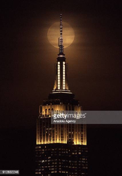 The Empire State building is seen as a full moon rises behind the building in New York United States on January 31 2018 The 'Super Blue Blood Moon'...