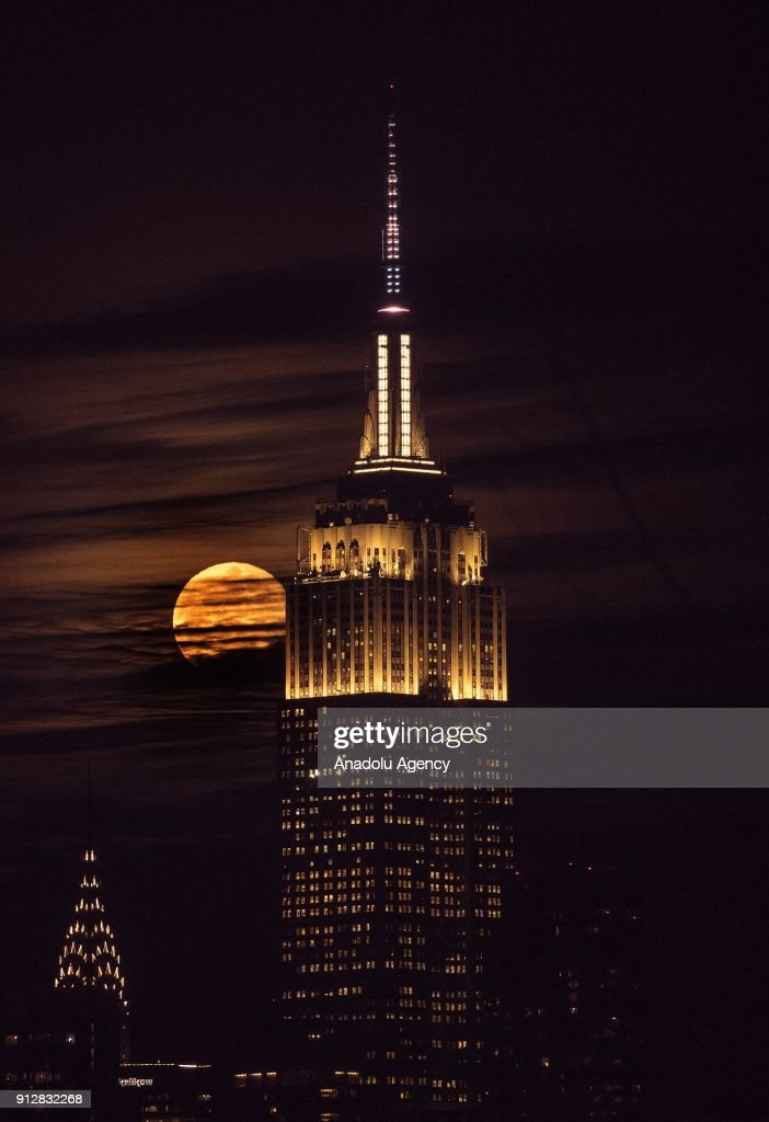 The Empire State building is seen as a full moon rises behind the building in New York, United States on January 31, 2018. The 'Super Blue Blood Moon' is a rare 'lunar trifecta' event in which the moon is at its closest to the earth, appearing bigger and brighter than usual and is simultaneously a 'blue moon', the second full moon in the same month, and in total lunar eclipse or 'blood moon'. For the first time in 152 years, a super moon, blue moon, and total lunar eclipse coincide.