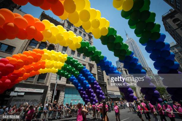 The Empire State Building is seen behind rainbow balloons during the 46th annual Gay Pride march June 26 2016 in New York New York kicked off June 26...
