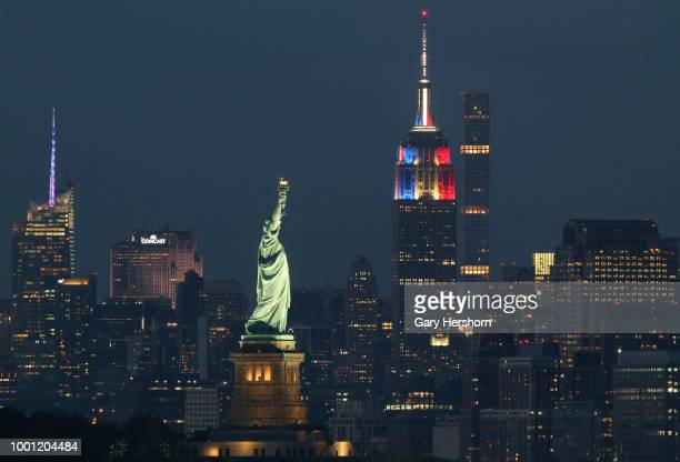 The Empire State Building shines in the colors of France behind the State of Liberty in honor of their FIFA 2018 World Cup victory on July 15 2018 as...
