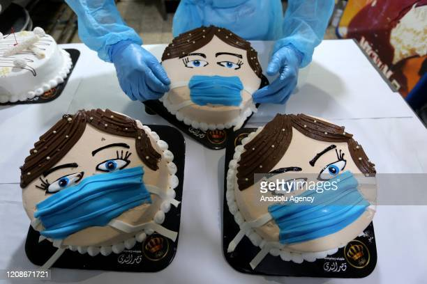 """The employees of a factory producing pastry make cakes in the form of a """"child wearing a mask"""" to raise awareness about the importance of using masks..."""