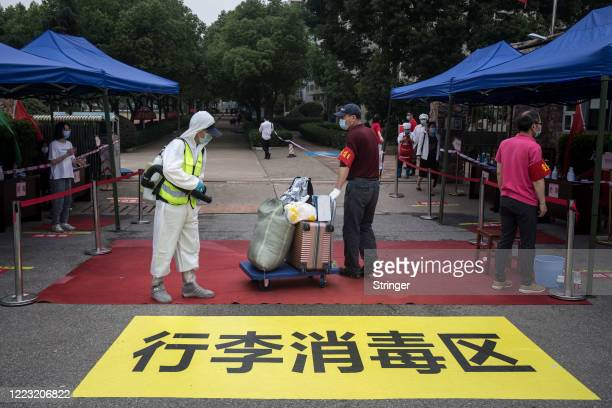 The employees of school disinfect the students' luggage at Wuhan Rayson School on May 6 2020 in Wuhan Hubei Province China Senior students in 121...