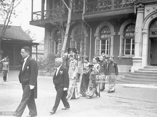 6/7/1934H M the Empress of Manchoukuo with her attendants after an audience with Prince Chichibu from whom her majesty received a decoration from the...