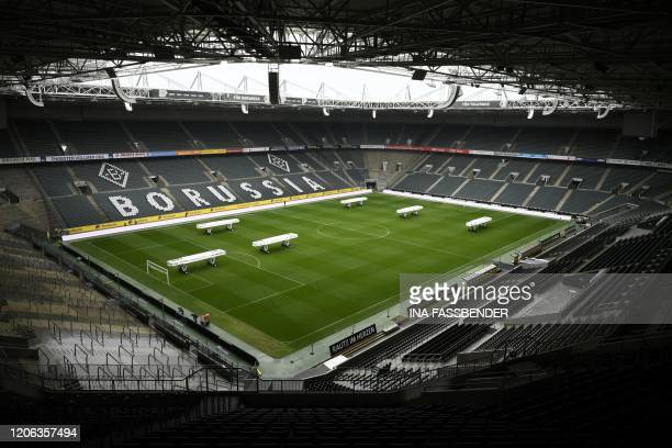 The empty BorussiaPark football stadium is pictured on March 10 2020 in Mönchengladbach Rhine Bundesliga derby between Borussia Moenchengladbach and...