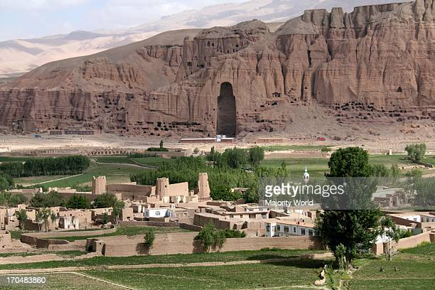 The empty cave of the Buddhas on the cliff of Bamyan valley in Hazarajat region of central Afghanistan The two monumental statues of standing Buddha...