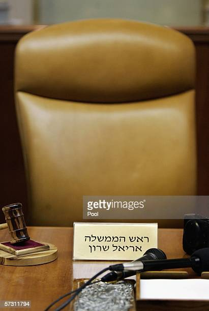 The empty chair and gavel of ailing Israeli Prime Minister Ariel Sharon is seen during a special meeting of the cabinet at the Prime Minister's...