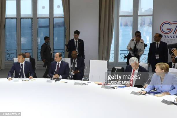 TOPSHOT The empty chair of US Presisdent Donald Trump is seen as French President Emmanuel Macron Egyptian President Abdel Fattah alSissi Chile...