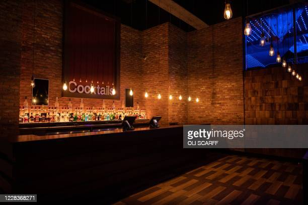 The empty cocktail bar in PRYZM nightclub in Birmingham is pictured inside the nightclub in central England on September 5 as it remains closed due...