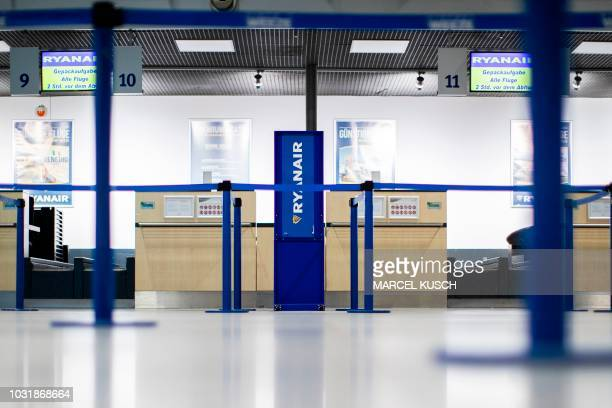 The empty counters of Irish airline Ryanair are cordoned off on early September 12 2018 at the airport of Western German airport of Weeze as German...