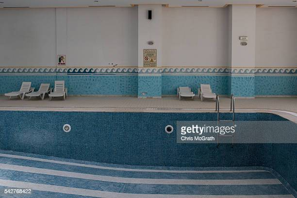The empty indoor swimming pool is seen at the closed Imperial Marhaba Hotel on June 24 2016 in Sousse Tunisia The Imperial Marhaba hotel was the main...