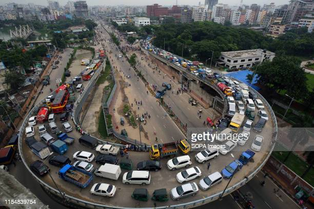 The empty lower road of Rampura U loop blocked by demonstrators during the protest A large number of rickshawpullers and owners blocked Dhaka roads...