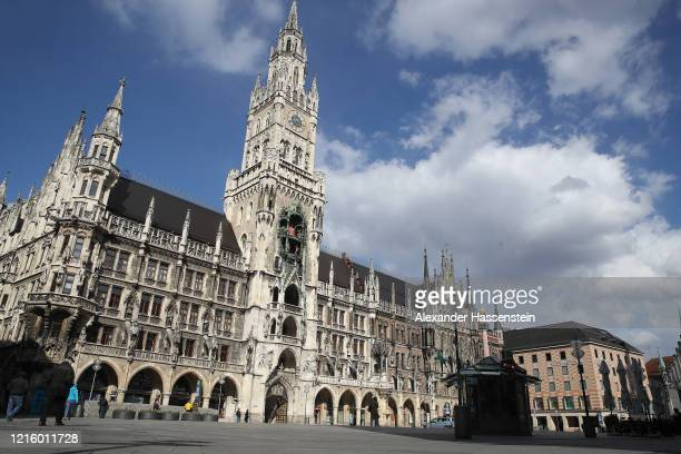 The empty Marienplatz with the Townhall of Munich is seen during the coronavirus crisis on March 31, 2020 in Munich, Germany. Public life in Germany...