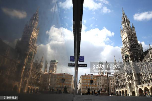 The empty Marienplatz with the Townhall of Munich is seen during the coronavirus crisis on March 31 2020 in Munich Germany Public life in Germany has...