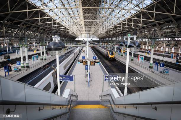 The empty platforms at Piccadilly train station during Monday morning rush hour Household isolation social distancing working from home avoidance of...