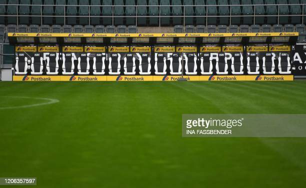 The empty players' bench is pictured at Borussia-Park football stadium on March 10, 2020 in Mönchengladbach. - Rhine Bundesliga derby between...