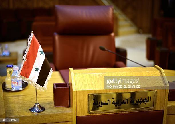 The empty seat of Syria is seen during an emergency representatives meeting to discuss the conflict in Libya at the Arab League headquarters in Cairo...