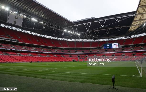 The empty stadium awaits supporters ahead of the English Premier League football match between Tottenham Hotspur and Arsenal at Wembley Stadium in...