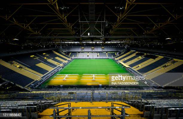 The empty stadium Signal Iduna Park of the Bundesliga club Borussia Dortmund is pictured in Dortmund, western Germany, on May 5 due to the spread of...