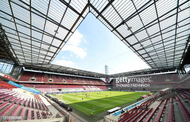 TOPSHOT The empty stands are seen during the German first division Bundesliga football match FC Cologne v Mainz 05 on May 17 2020 in Cologne western...