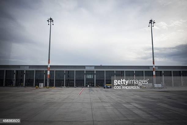 The empty terminal building of the not yet opened Berlin Brandenburg Airport in Schoenefeld on November 4 2014 AFP PHOTO / ODD ANDERSEN