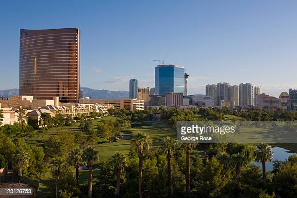 The Encore/Wynn Hotel Casino golf course and Las Vegas Strip is seen from a parking structure on August 12 in Las Vegas Nevada With tourism slowly...