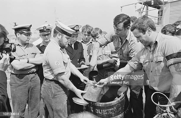 The end of a Royal Navy tradition as the daily ration of rum is abolished due to safety concerns 31st July 1970 LSA Michael Johns pours a final tot...