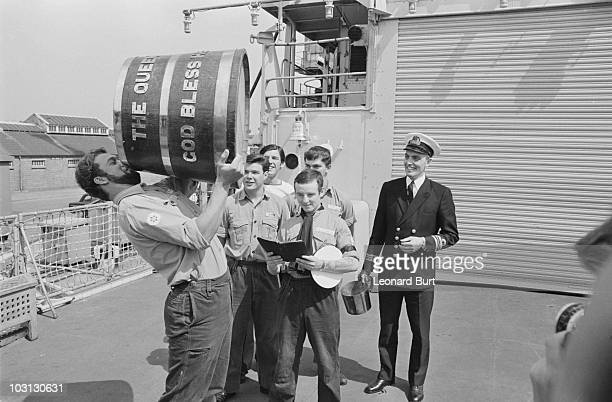 The end of a Royal Navy tradition as the daily ration of rum is abolished due to safety concerns 31st July 1970 Cook Thomas McKenzie drains the last...