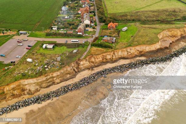 The end of a tarmac road shows the devastation caused by coastal erosion of the cliff face in the village of Happisburgh on November 06, 2019 in...
