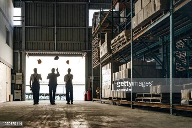 the end of a working day in a warehouse! - endopack stock pictures, royalty-free photos & images