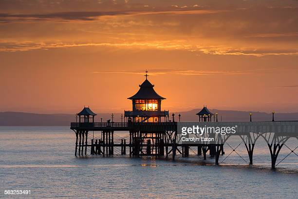 the end of clevedon pier at sunset - clevedon pier stock pictures, royalty-free photos & images